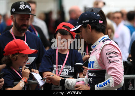 Silverstone Circuit. Northampton, UK. 13th July, 2019. FIA Formula 1 Grand Prix of Britain, Qualification Day; SportPesa Racing Point, Sergio Perez stops for fans Credit: Action Plus Sports/Alamy Live News - Stock Image