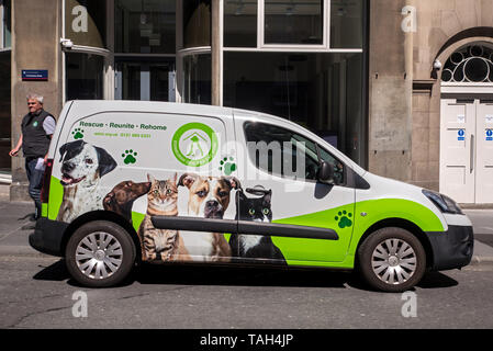 Van from the Edinburgh Cat and Dog Home charity parked on a street in Edinburgh. - Stock Image