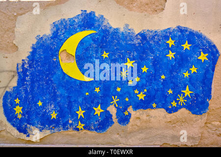 Wall art in Mostar, where the painter used bullet and shrapnel holes as part of design. Starry sky, with stars prior hole - Stock Image