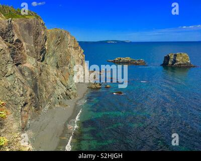 Skerwink trail in Newfoundland showing ocean views with cliffs and rocks - Stock Image