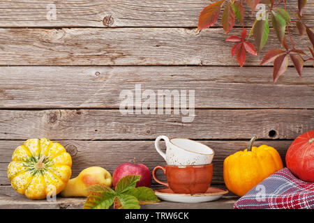 Autumn still life with pumpkins, apples, pears and colorful leaves. With space for your text - Stock Image