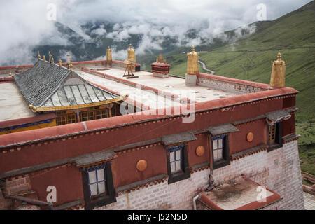 Golden dhvaja on roof line of Ganden Monastery, Lhasa, Tibet, shot in 2007 - Stock Image