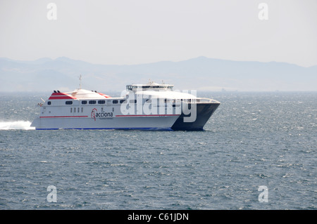 High speed catamaran crossing the Straights of Gibraltar as viewed from Royal Caribbean Cruises Independence of - Stock Image