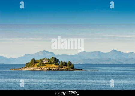 Guard Island and decomissioned lighthouse, originally built in 1903, at entrance to Tongass Narrows, near Ketchikan, Alaska. - Stock Image