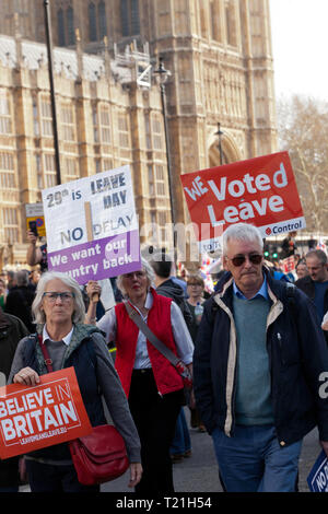Protestors march by the Houses of Parliament during a demonstration  against the delay to Brexit  on the day the UK should have left  the EU - Stock Image
