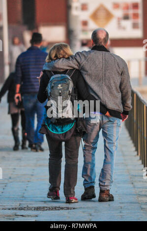 Middle aged couple walking together in love - Stock Image