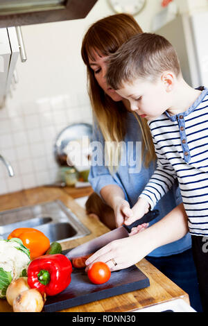 Preparing vegetables in the kitchen - Stock Image