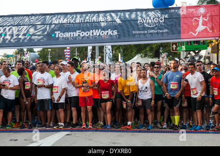 Runners at start of 2014 Mercedes-Benz Corporate Run in Miami, Florida, USA. - Stock Image