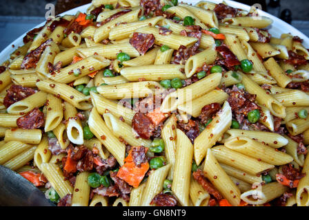 Penne pasta salad with spicy chorizo sausage & vegetables - Stock Image