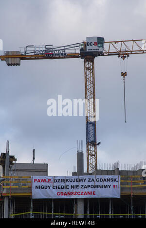 "Banner saying ""Pawel, thank you for Gdansk. We will never forget you. Citizens of Gdansk"" placed on a construction site after assassination of mayor - Stock Image"