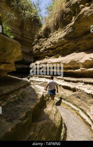 A male tourist waling in Ol Njorowa gorge, Hells Gate National Park, Kenya - Stock Image