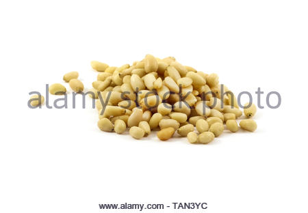 Pile of pine nuts isolated on white background - Stock Image
