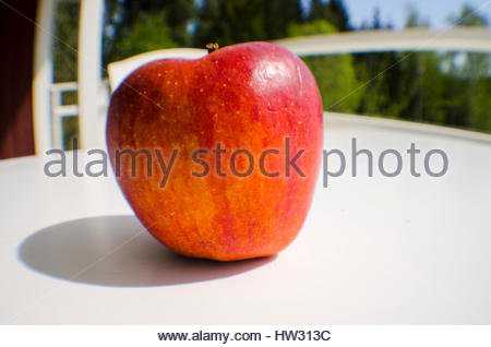 An apple a day keeps the doctor away, is an old saying. Maybe true. - Stock Image