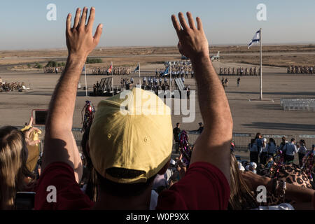 Hazerim Air Base, Israel. 27th June, 2019. Families and friends attend a graduation ceremony honoring newly certified Israel Air Force pilots and navigators following their successful completion of one of the most competitive and rigorous training processes in the IDF at Hazerim Air Base in the Negev Desert. Credit: Nir Alon/Alamy Live News. - Stock Image