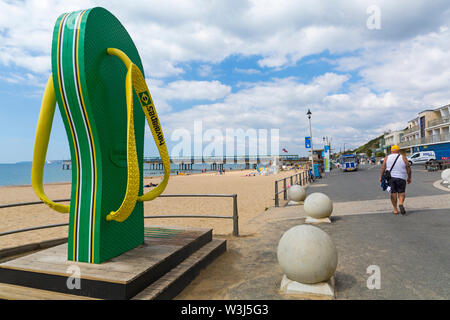 Large giant flip flip, flipflop, shower, on promenade seafront at Boscombe, Bournemouth, Dorset UK in July - Stock Image