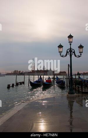 Sunset in flooded Venice with view on Chiesa di San Giorgio Maggiore - Stock Image
