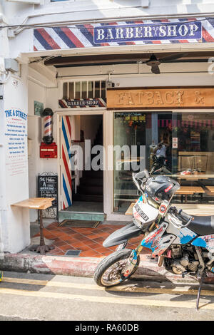 Singapore - 22nd December 2018: Motorbike outside a barber shop in Haji Lane. This is in the Kampong Glam area - Stock Image
