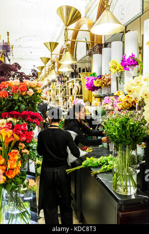 Florists, florist, working at florist, making bouquets, working with flowers, making flower display, making bouquet, - Stock Image