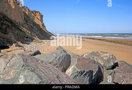 A view looking westwards along the beach at the North Norfolk seaside resort of East Runton, Norfolk, England, United Kingdom, Europe. - Stock Image