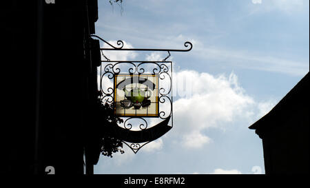 a salon de tea signpost in th historic picturesque medieval town of Moncontour, Brittany,  Northern France. A pretty - Stock Image