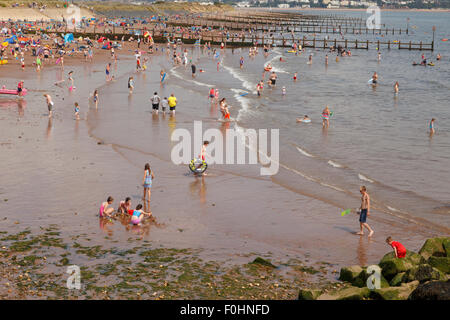 Beach holiday - crowded beach at Dawlish Warren, Devon. - Stock Image