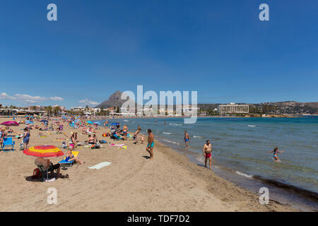 Playa del Arenal beach Xabia Spain in summer with blue sky and people, also known as Javea - Stock Image