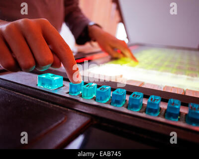 boy selects songs on push button juke box - Stock Image