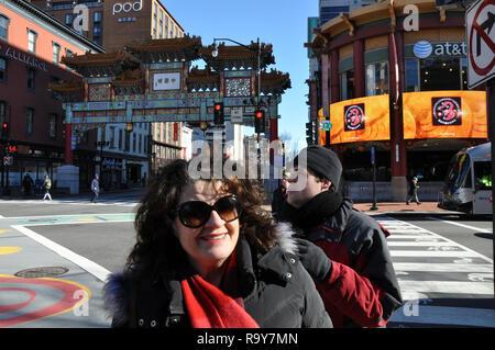 Woman and Man Tourist Shopping in Chinatown, Washington DC - Stock Image