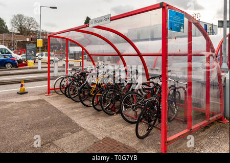 Bikes in a bike rack at Coventry Railway Station, Coventry, West Midlands, UK. - Stock Image