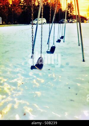 Swing set in winter - Stock Image