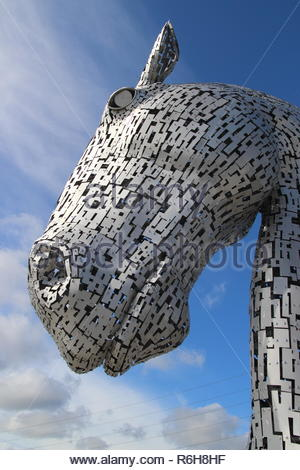 Looking up at one of the kelpies in the Helix Park, Falkirk Scotland, UK. - Stock Image