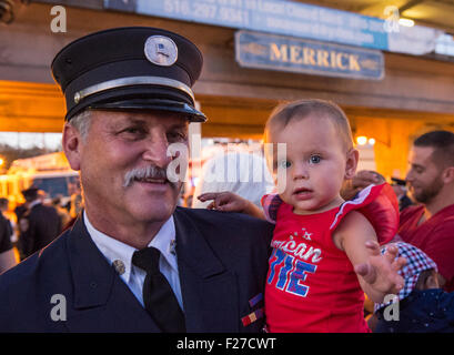 Merrick, New York, USA. 11th September 2015. RILEY E. GIES, one-year-old granddaughter of Fire Chief Ronnie E Gies - Stock Image