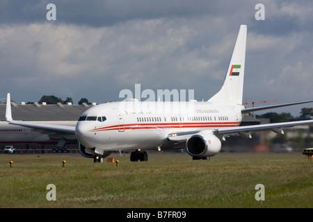 United Arab Emirates (Dubai Air Wing) Boeing 737-8AJ BBJ2 taking off at Farnborough. - Stock Image