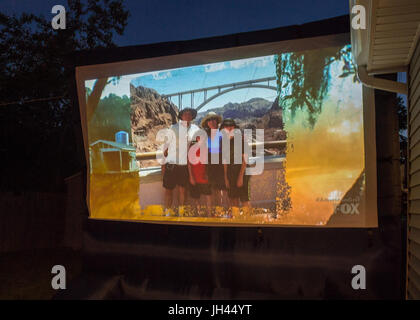 Merrick, New York, USA. 11th June 2017.  Family vacation photo shown on large screen is of 'American Grit' - Stock Image