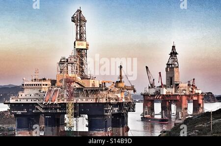 Moored oil rigs - Stock Image