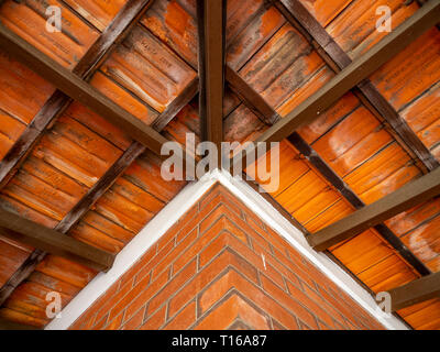 Underside of a terracotta roof of a residential veranda. - Stock Image