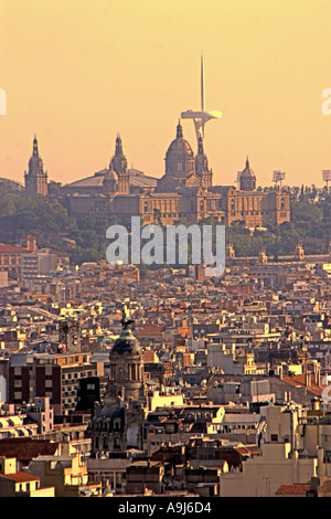 ESP Spanien Barcelona Palau National Olympic Tower Montjuic by architect Norman Forster Teleshot from Sagrada Familia - Stock Image