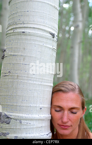 Healthy Woman in Stand of Trees Uinta National Forest Park City Utah - Stock Image