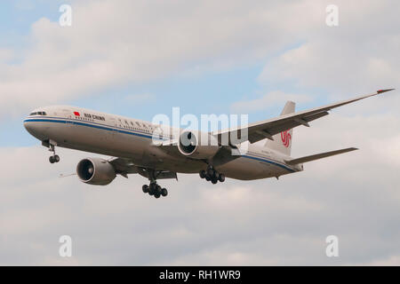London, Uk - August 6, 2013 - An Air China  airplane lands at Heathrow Airport in London - Stock Image