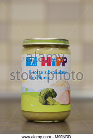 Polish Hipp baby food with risotto and broccoli in a glass jar - Stock Image