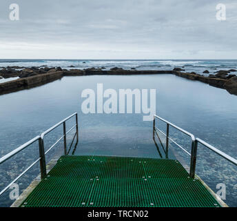 Protected natural swimming pool on the rugged north coast of Gran Canaria. - Stock Image