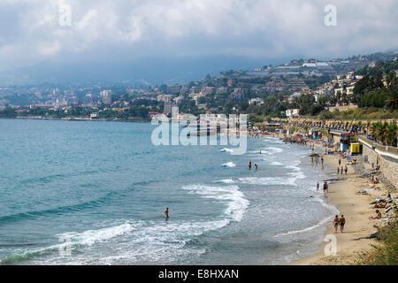 Beach along the Riviera dei Fiori near San Remo, Liguria, Italy - Stock Image