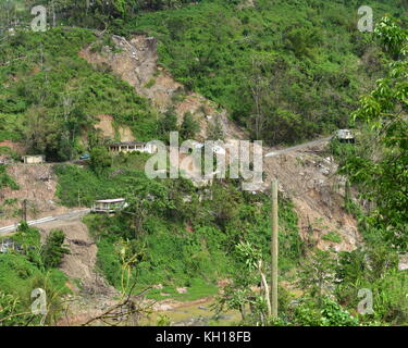 Aerial view of homes damaged by a landslide caused by Hurricane Maria November 2, 2017 in Lares, Puerto Rico.   - Stock Image