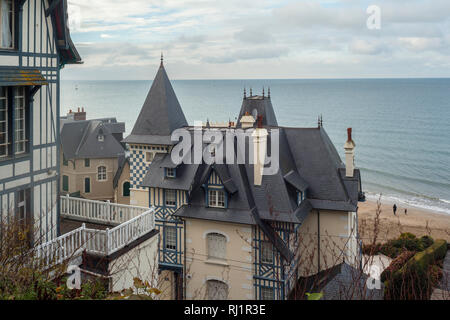 Looking out to sea beyond iconic Belle Epoque houses in Trouville-sur-Mer, Normandy, France. - Stock Image