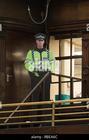 cardboard cutout policeman police officer at Glasgow Central Station, Scotland, UK - Stock Image