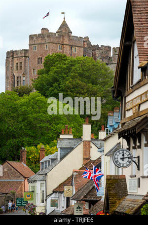 Dunster Exmoor Somerset England UK. May 2019 Showing Dinster Castle and Yarn Market Dunster is a village, civil parish and former manor within the Eng - Stock Image