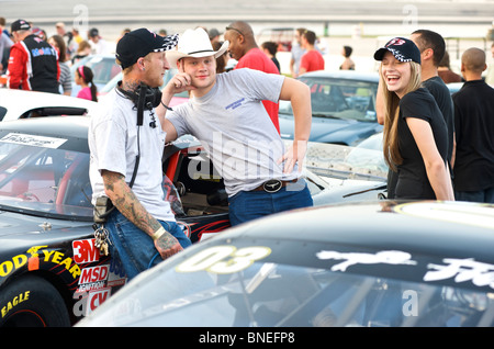Friends in discussion at Nascar car racing circuit Houston, Texas, USA - Stock Image
