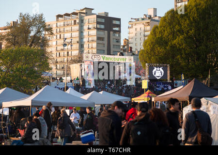 VANCOUVER, BC, CANADA - APR 20, 2019: Overview of the crowds and vendors at the 420 festival in English Bay, Vancouver. - Stock Image