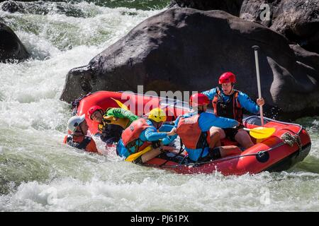 Soldiers and marines from the Australian Army, the Chinese People's Liberation Army Marine Corps, the United States Army, and the United States Marine Corps go white water rafting on the Tully River during Exercise Kowari 2018. - Stock Image