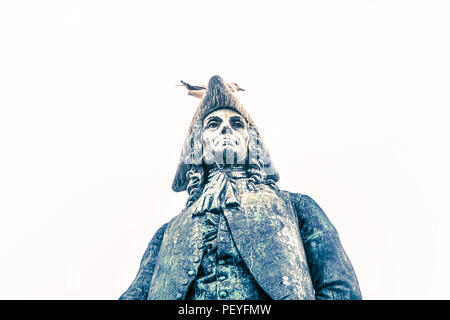 Bergen, Norway, July 23, 2018: Statue of poet Ludvig Baron Holberg serves as rest for a seagull and is covered in bird litter. - Stock Image